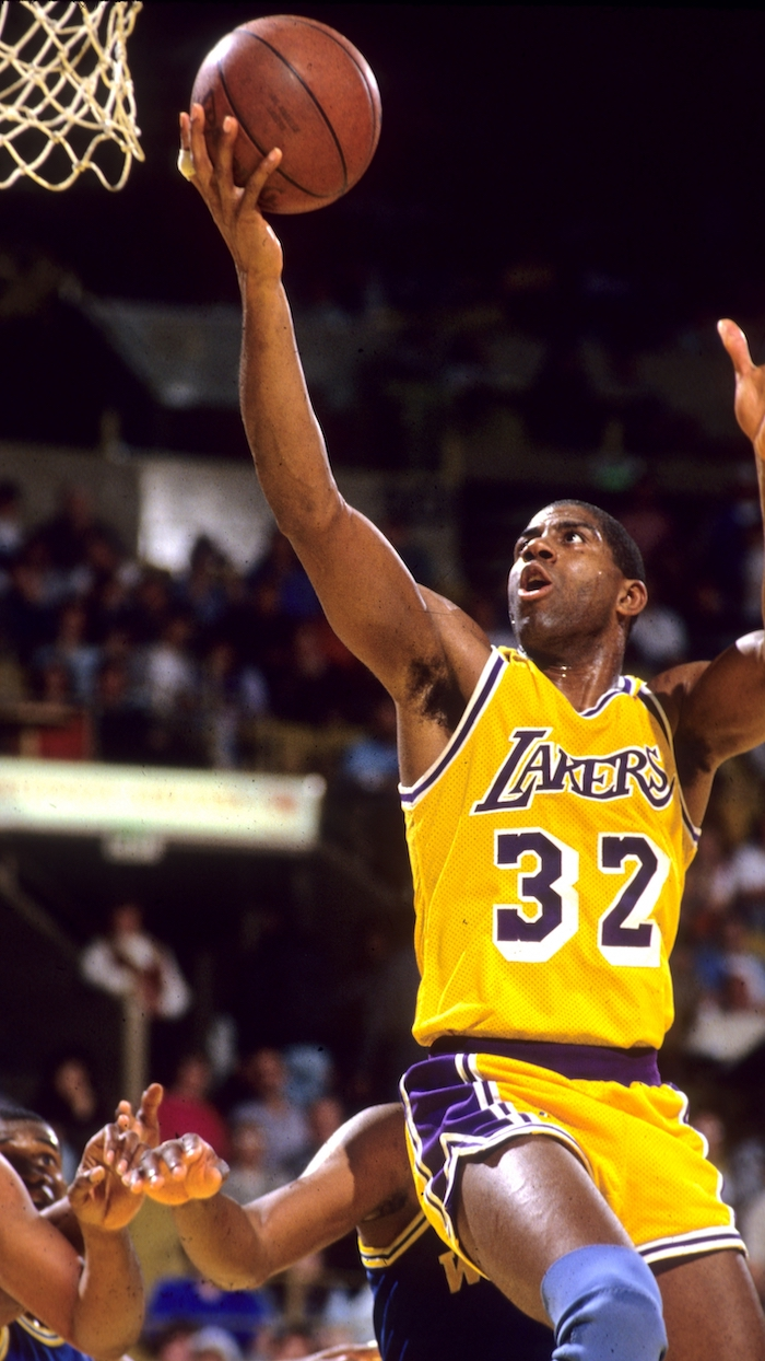 magic johnson photographed on the court wearing gold lakers uniform lakers wallpaper iphone