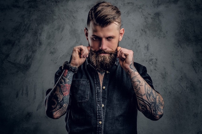 man with beard wearing denim shirt arm sleeve tattoos on both hands tattoo ideas for men gray background