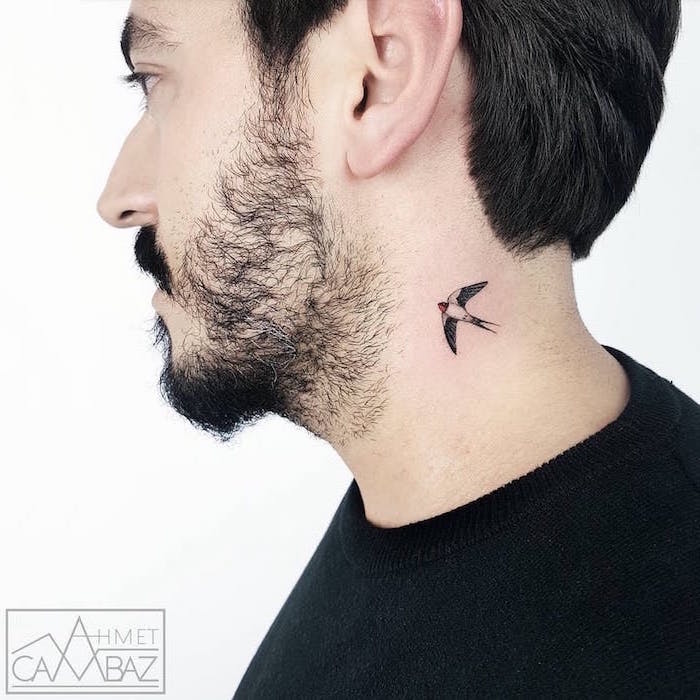 meaningful tattoos for men small neck tattoo of bird with spread wings on man wearing black sweater white background