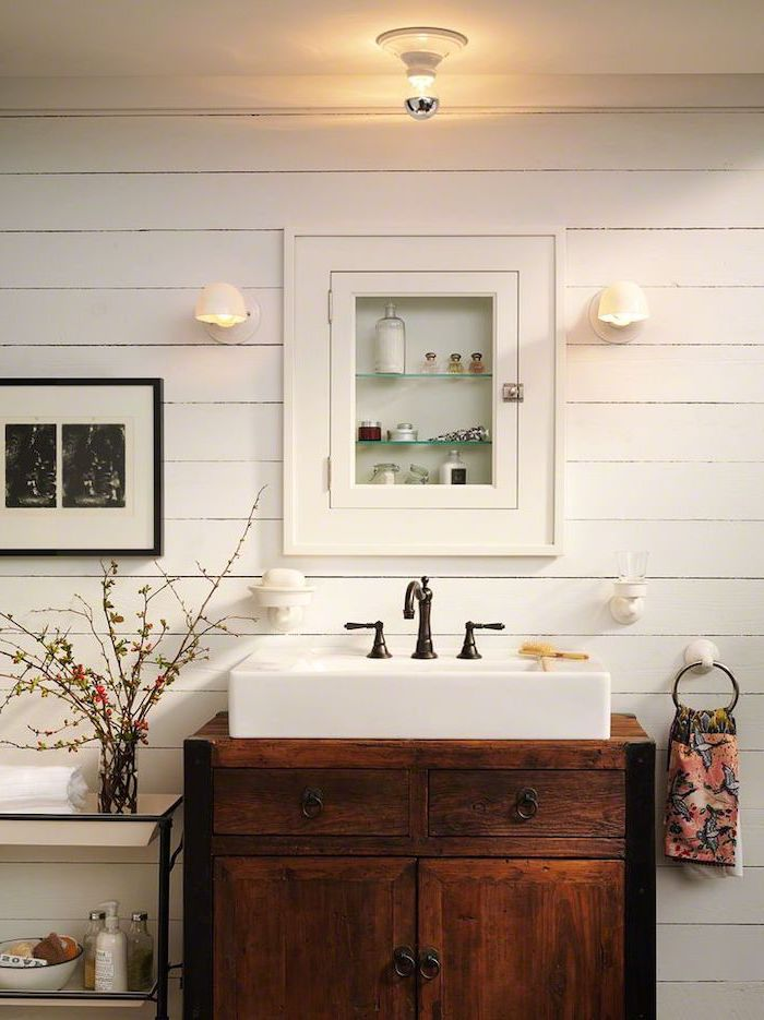 medicine cabinet on wall with white shiplap bathroom decor signs wooden vanity with sink with dark vintage faucet