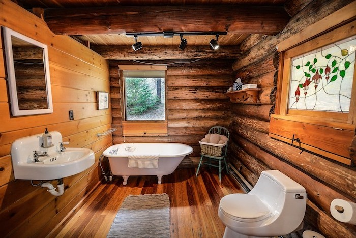 modern farmhouse bathroom vanity all wooden walls floor and ceiling with exposed wood beams