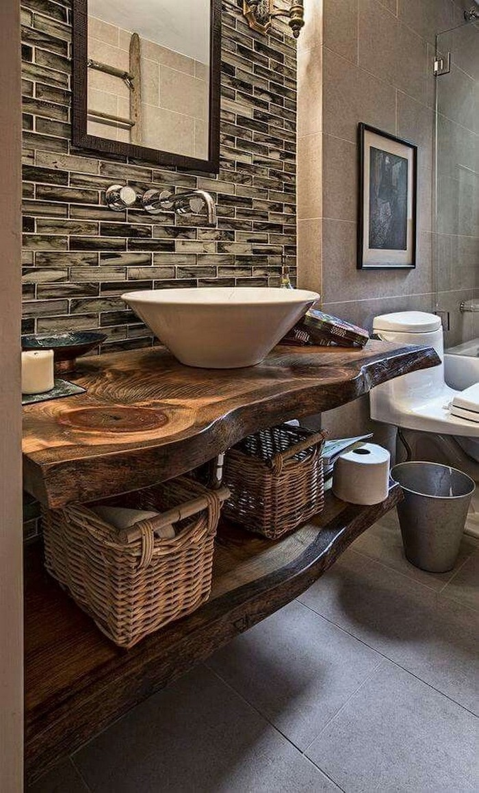 modern farmhouse bathroom wooden shelves with sink mirror above it gray tiles on the floor open shelving