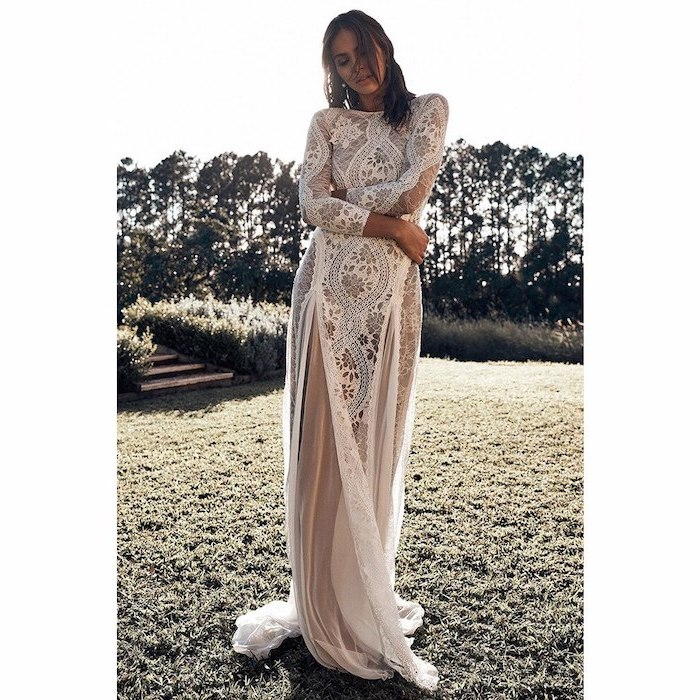 plus size boho wedding dress worn by woman with shoulder length wavy hair wearing all lace dress with long sleeves