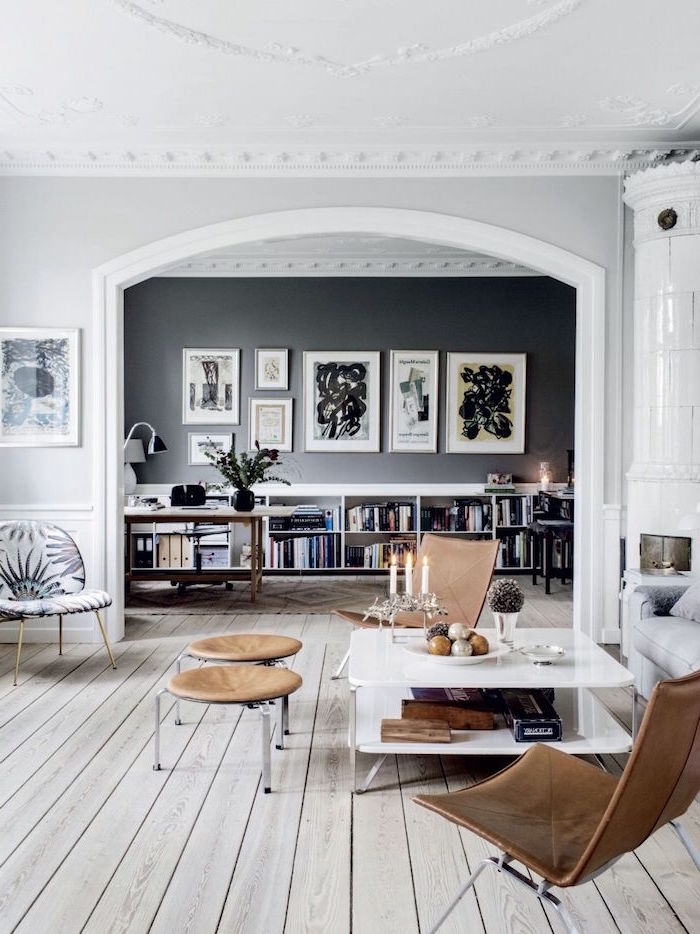 scandinavian decor wooden floor in living room with gray sofa two brown leather armchairs white coffee table
