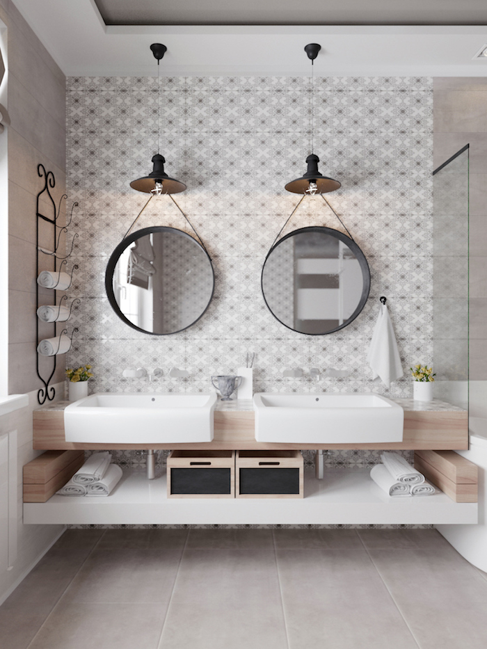 scandinavian home decor bathroom with wooden floating vanity two round mirrors on wall with patterned tiles