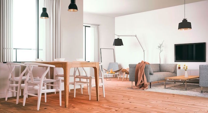 scandinavian interior design wooden dining table and chairs gray sofa small wooden coffee table white walls