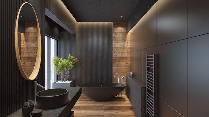 scandinavian minimalism black walls wooden floor and wooden accent behind black bathtub in bathroom
