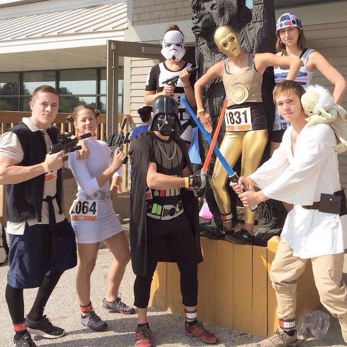 seven people dressed as star wars characters group halloween costumes luke skywalker anakin princess leia darth vader