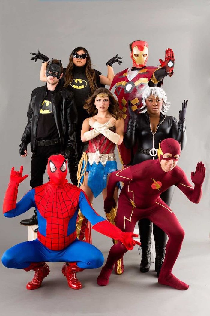 seven people dressed as superheroes from marvel dc comics trio halloween costumes batman batwoman iron man flash wonder woman storm spider man