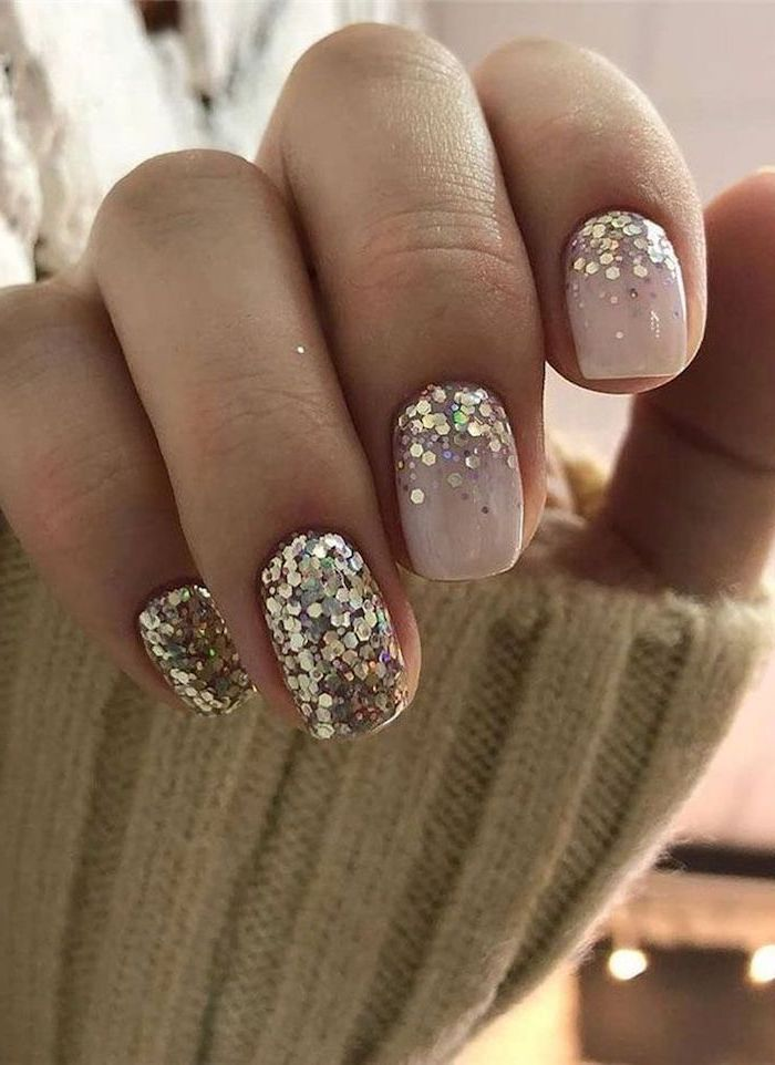 short squoval nails almond shaped nails nude nail polish gold glitter on the ring and pinky fingers