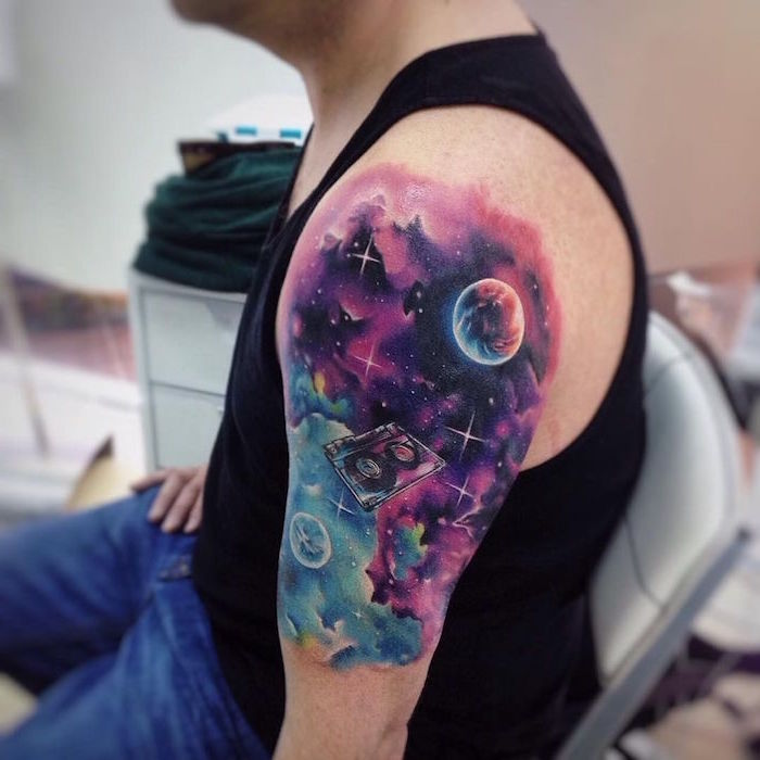 shoulder watercolor tattoo of galaxy sky in purple pink blue cassette tape floating around meaningful tattoos for men