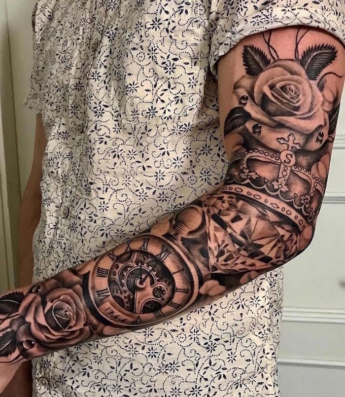 sleeve tattoo on man wearing white shirt forearm tattoos for men roses with compass diamond crown