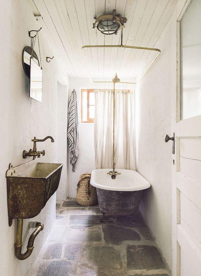 stones on the floor farmhouse bathroom shelves vintage bath and sink white shiplap on the ceiling white walls