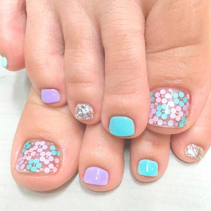 summer acrylic nail designs blue purple and silver glitter nail polish flower decorations on toes