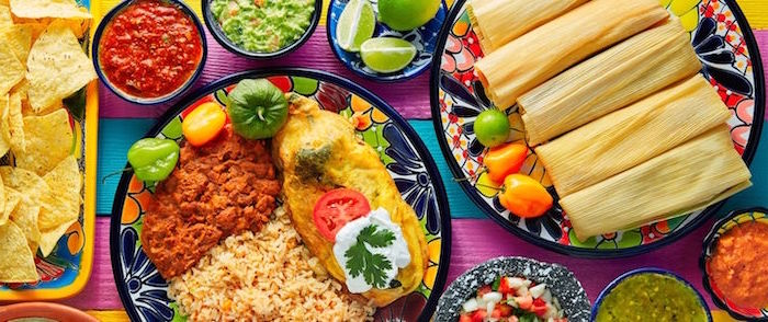 tamales mexican rice on colorful plates mexican dishes on colorful surface small bowls with different dips