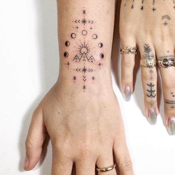 tattoo ideas with meanings hand wrist and finger tattoos phases of the moon geometric symbols mountain landscape