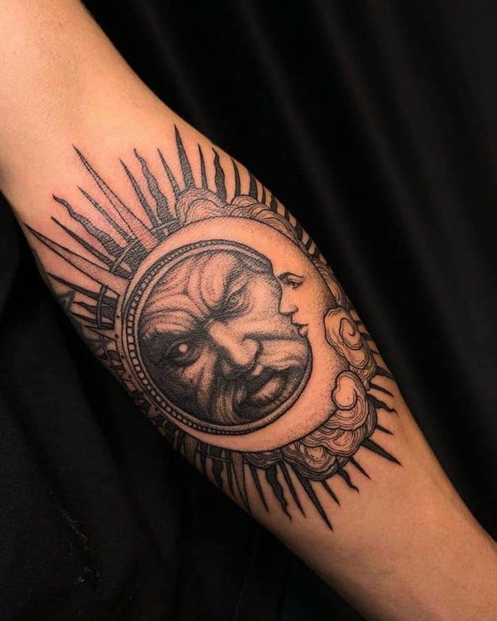 tattoos that mean strength sun and moon connected together with male and female face forearm tattoo