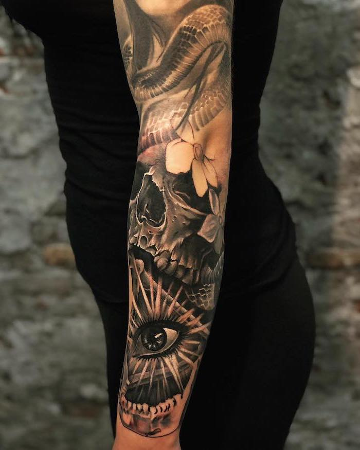 tattoos with deep meaning whole arm sleeve tattoo of dragon skull flowers all seeing female eye on woman wearing black leggings top