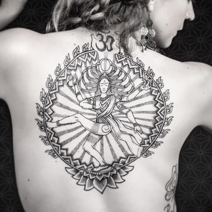 tattoos with meaning of life vishnu goddess inside a circle with om symbol on top lotus flower on the bottom back tattoo