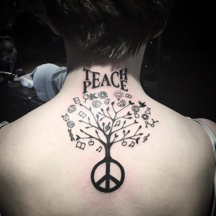 teach peace written above tree with piece sign and different symbols symbols with deep meanings back tattoo