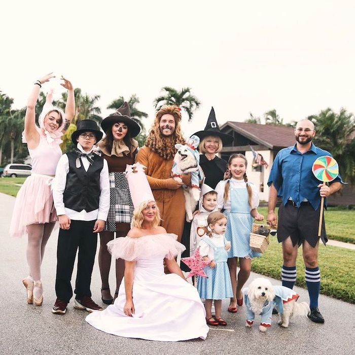 ten people dressed as characters from the wizard of oz photographed on the street halloween costume ideas for girls