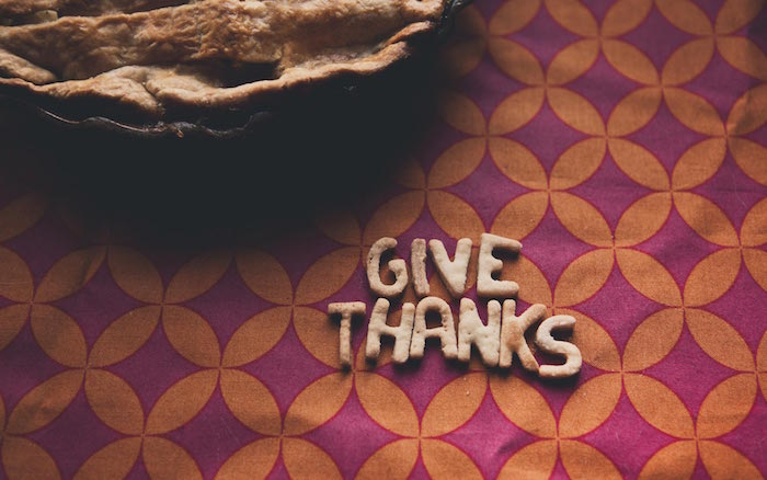 thanksgiving desktop wallpaper give thanks written with dough next to pie background in purple and orange