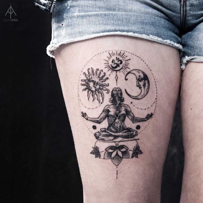 thigh tattoo with om symbol woman meditating sun and moon around it tattoos with deep meaning