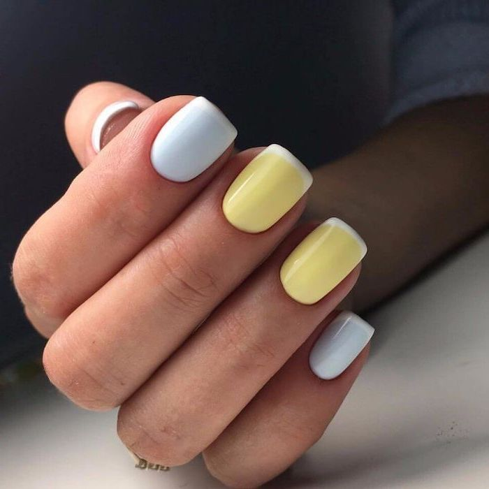 three nails in blue ring and middle finger with yellow nail polish cute nail ideas white french manicure short squoval shape