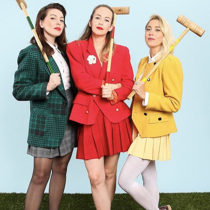 three women dressed as characters from heathers funny diy halloween costumes wearing green red yellow suits