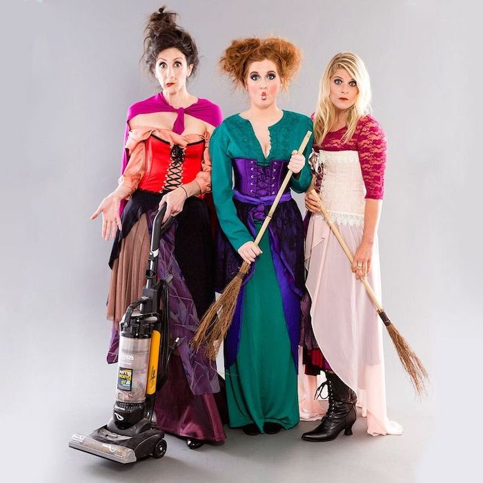 three women dressed as the witches from hocus pocus halloween costumes for 3 people photographed in front of white background