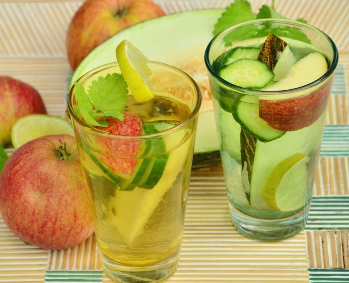 two glasses filled with apples cucumbers lemons melons how to detoxify your body melon and apples on the table