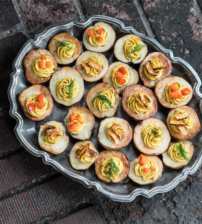 vegan appetizer recipes deviled potatoes halved baked filled with egg mixture garnished with tomatoes dill
