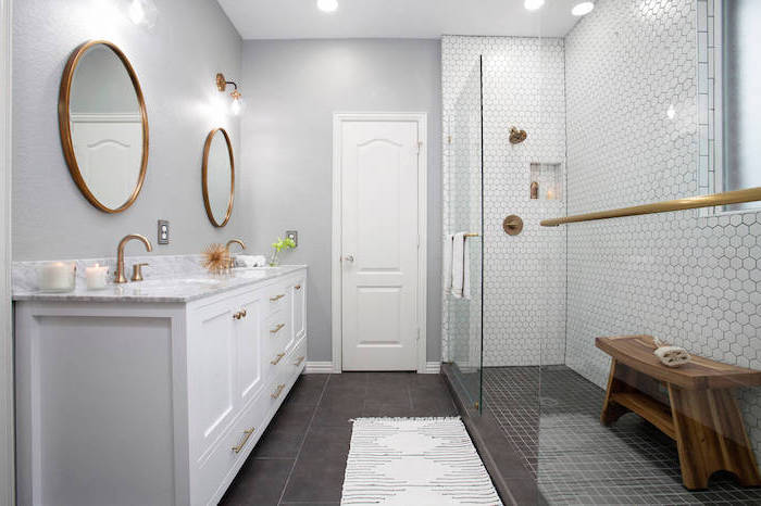 what is scandinavian all white bathroom white vanity with two round mirrors white honeycomb tiles on the wall in the shower