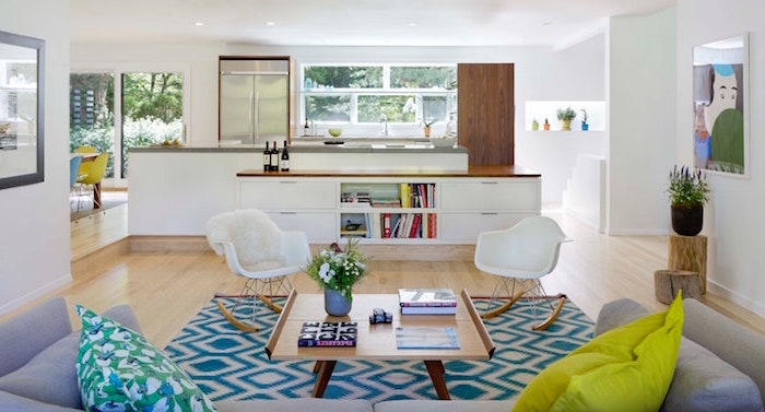 white armchairs and kitchen in all white gray sofa scandinavian minimalism blue and white carpet on wooden floor