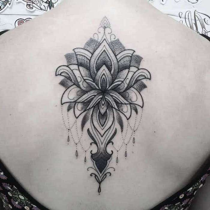 white background strength symbol tattoo lotus flower mandala tatoo on the back of woman