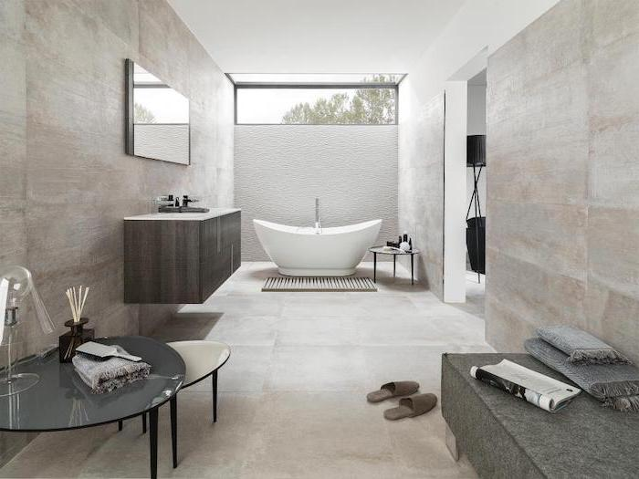 white bathtub with white 3d tiled accent wall behind it bathroom floor tile ideas light gray tiles on the walls and floor