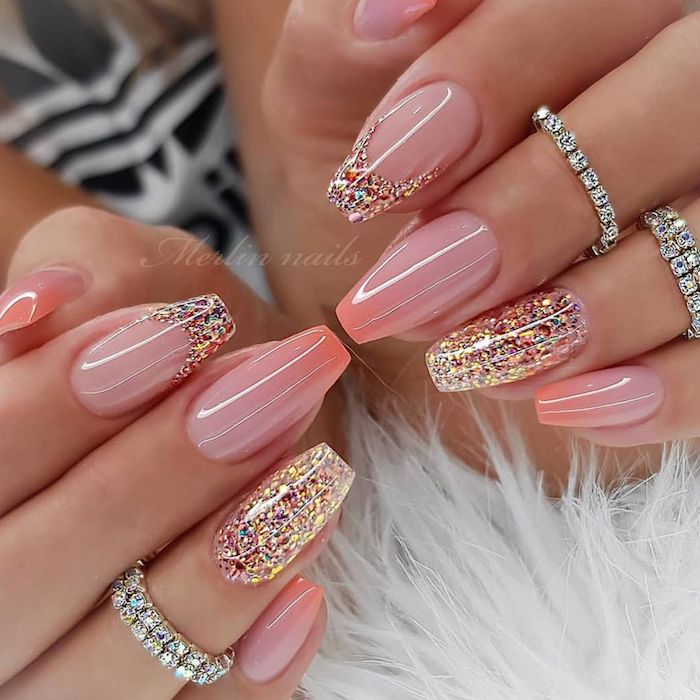 white fur under two hands with long square nails acrylic nail designs pink nails pink glitter on the ring fingers