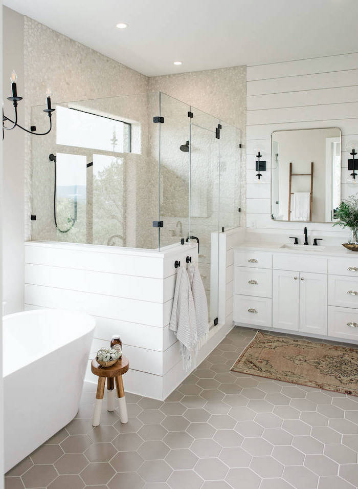 white shiplap on the wall behind the vanity gray honeycomb tiles on the flor cobble stone in the shower farmhouse bathroom ideas