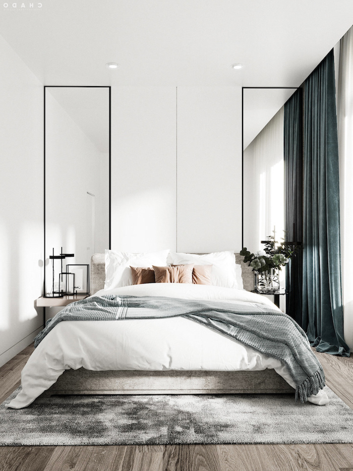 white walls two large mirrors on both sides of bed scandinavian decor green velvet curtains gray rug on wooden floor