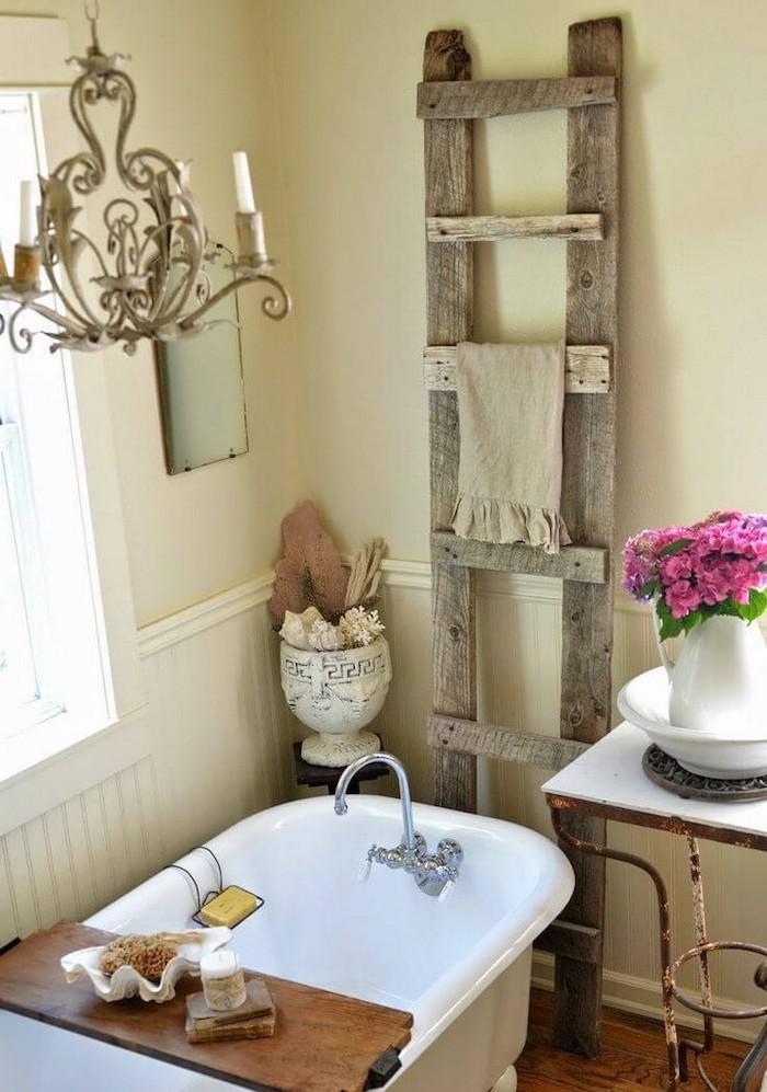 white walls vintage bath wooden ladder behind it for towels farmhouse bathroom decor vintage chandelier