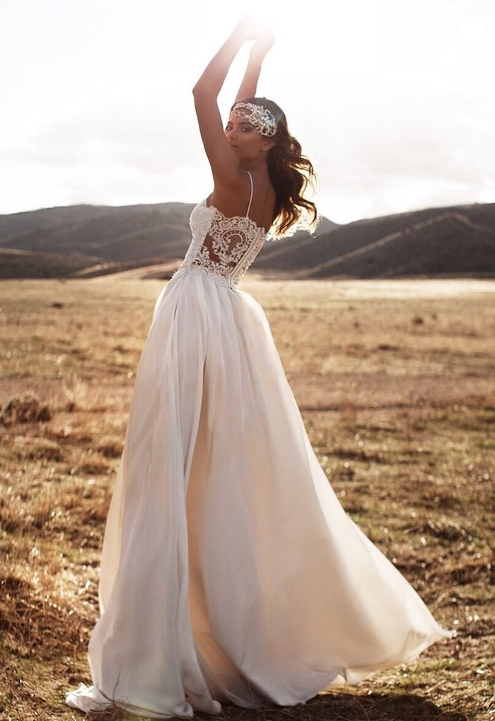 woman wearing white dress with lacy top bottom skirt made of tulle plus size boho wedding dress with brunette hair
