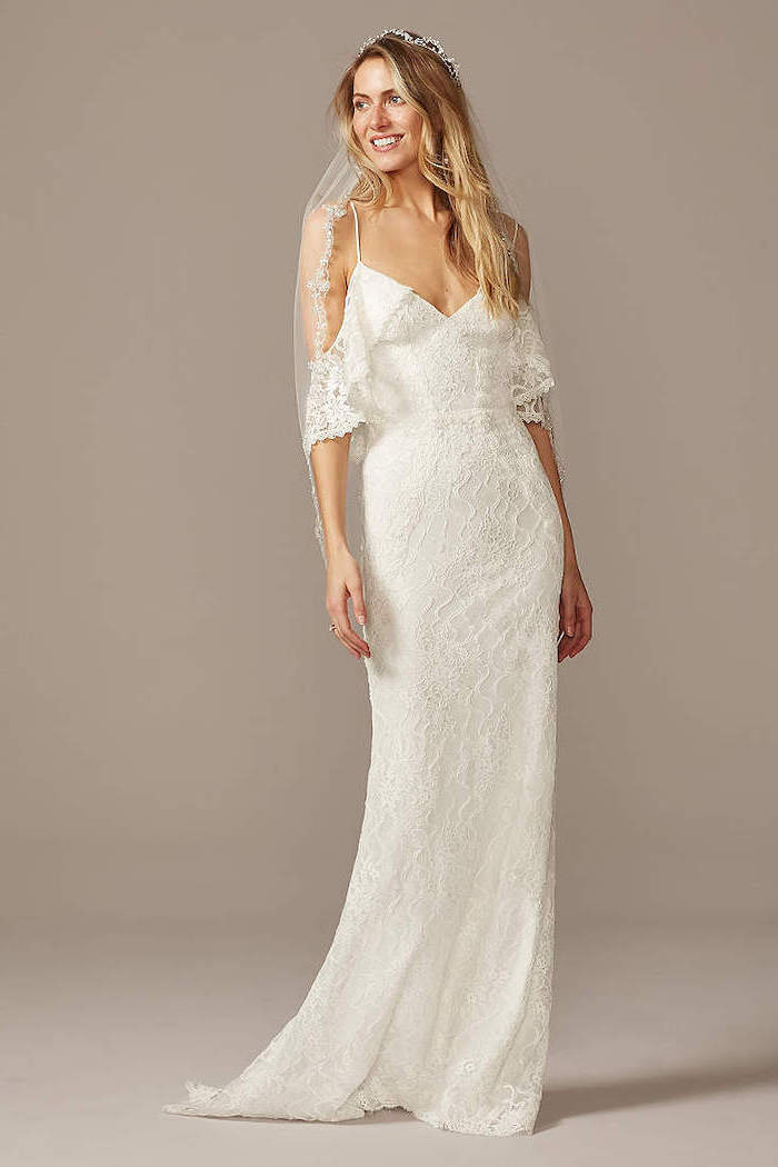 woman wearing white lacy dress bohemian style wedding dresses with medium length wavy blonde hair