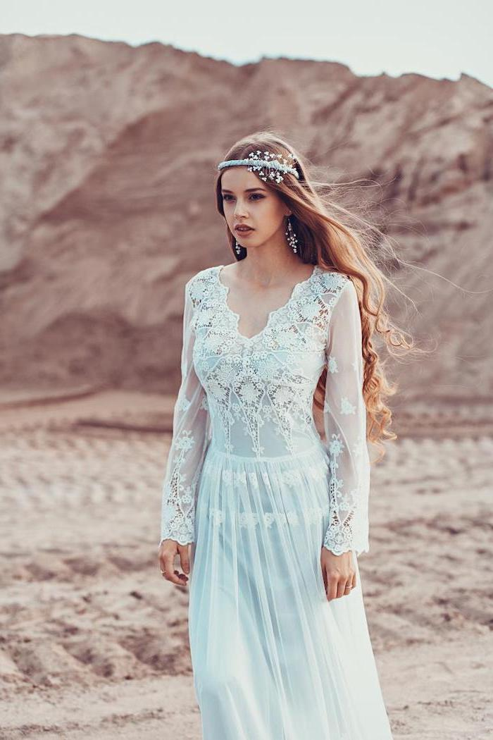woman with long curly dark blonde hair wearing lace and tulle wedding dress with long sleeves unique wedding dresses