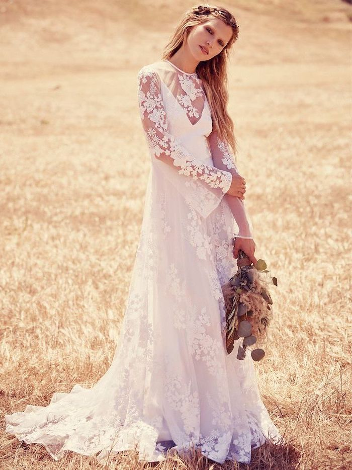 woman with long wavy blonde hair flowy wedding dress wearing dress made of tulle and lace with long sleeves