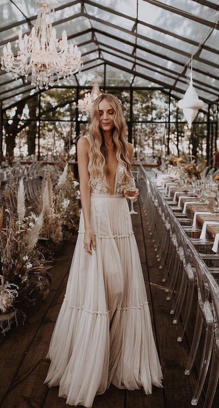 woman with long wavy blonde hair plus size beach wedding dresses wearing long dress with lacy top and bottom skirt made of tulle