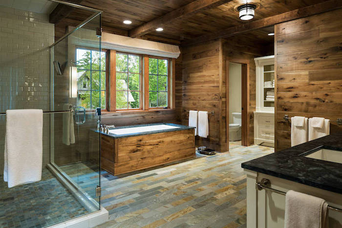 wood on the walls stone tiles on the floor farmhouse bathroom ideas exposed wood beams on the ceiling separate shower with white subway tiles