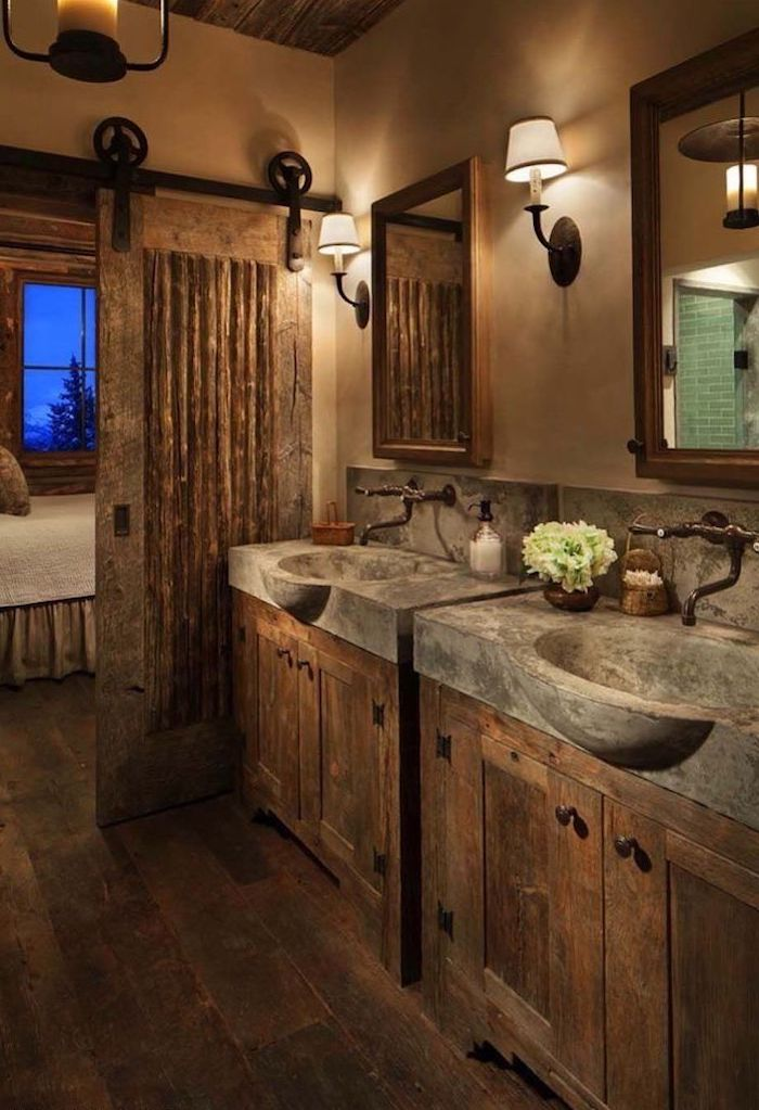 wooden vanities with stone sinks and two mirrors above them farmhouse bathroom shelves barn doors