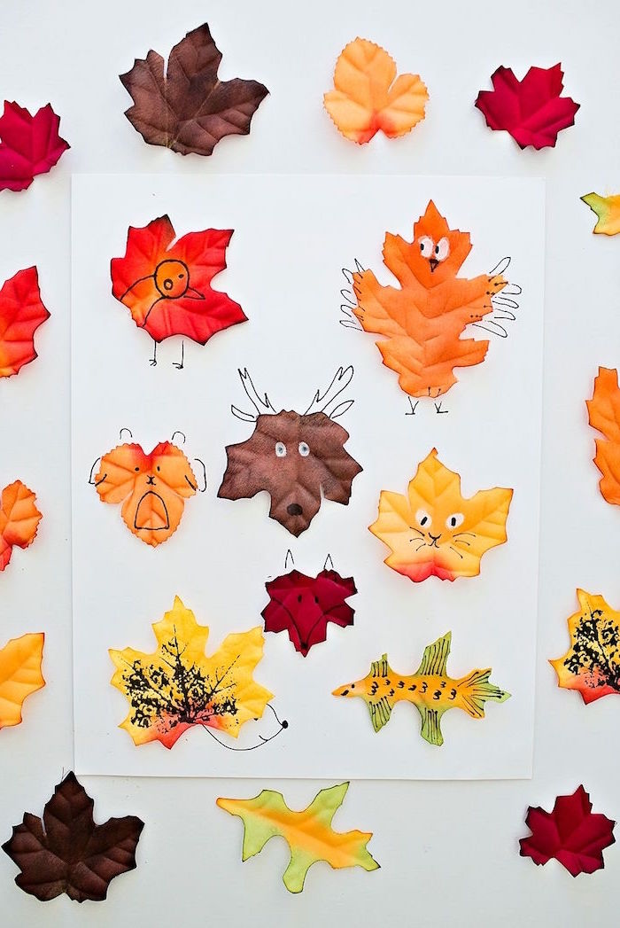 activities for kids at home white background lots of fall leaves in brown orange and yellow made as animals