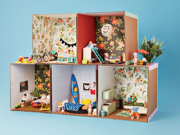 activities for toddlers at home five carton boxes built together as a doll house decorated with craft paper and mini furniture and dolls