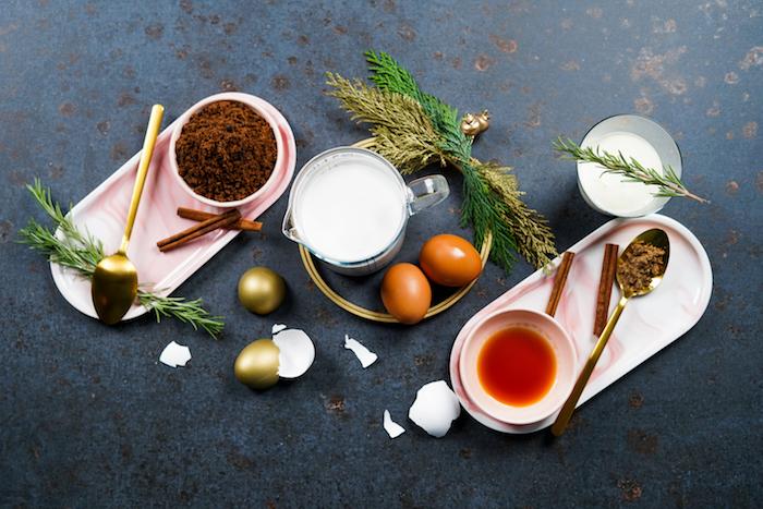 alternative christmas dinner ideas eggnog ingredients arranged on black surface milk eggs brown sugar